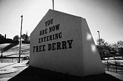 Irish Artists Framed Prints - you are now entering free derry gable wall painting with petrol bomber mural in the background at free derry corner in the bogside area of Derry Londonderry Framed Print by Joe Fox