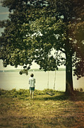 Missing Child Photo Prints - Young boy looking out at the water under a big tree Print by Sandra Cunningham