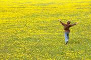 Light-years Posters - Young Boy Running Through Field Of Poster by Gemstone Images