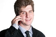Phone Conversation Posters - Young business man on the cell phone Poster by Gunter Nezhoda