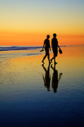 Young Couple Posters - Young Couple on Romantic Beach at Sunset Poster by Colin and Linda McKie