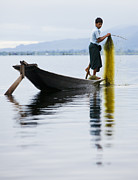 Young Man Framed Prints - Young fisherman in Inle Lake Framed Print by Ruben Vicente