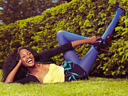 Joyful Posters - Young Happy Black Woman Lying on the Grass Poster by Oleksiy Maksymenko