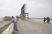 Scheveningen Pier Posters - Young Lady on the Pier in Scheveningen Netherlands Poster by Ronald Jansen
