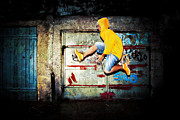 Adolescence Posters - Young man jumping on grunge wall Poster by Michal Bednarek