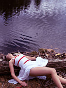 Abducted Prints - Young woman in dress and bondage rope lying near water Print by Oleksiy Maksymenko