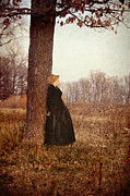 Contemplating Framed Prints - Young Woman in Vintage Clothing Leaning on Tree Framed Print by Jill Battaglia