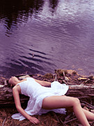 Dead Woman. Woman Lying Posters - Young woman in white dress lying near lake Poster by Oleksiy Maksymenko