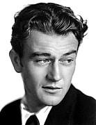 Youthful Photo Prints - Youthful John Wayne publicity photo c.1931 Print by David Lee Guss