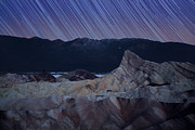 Stars Trail Posters - Zabriskie point star trails Poster by Jane Rix