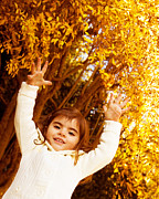 Raised Arms Posters -  Baby girl in autumn park Poster by Anna Omelchenko