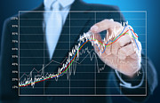 Success Prints -  Businessman Writing Graph Of Stock Market  Print by Setsiri Silapasuwanchai