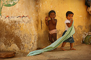 Outlook Photos -  Indian children near yellow wall in the village of Kanyakumari by Anastasiia Kononenko