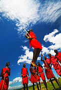 Folk Dancing Posters -  Masai warriors dancing traditional jumps Poster by Anna Omelchenko