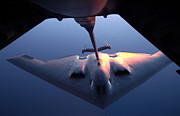 Mechanism Photo Prints - A B-2 Spirit Bomber Conducts Print by Stocktrek Images