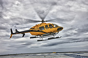 Rotorcraft Photo Prints - A Bell 407 Utility Helicopter Prepares Print by Terry Moore