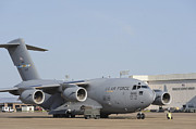 Military Base Posters - A C-17 Globemaster Iii Parked Poster by Stocktrek Images