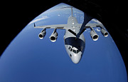 Mechanism Photo Prints - A C-17 Globemaster Iii Receives Fuel Print by Stocktrek Images
