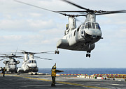 In A Row Art - A Ch-46e Sea Knight Helicopter Takes by Stocktrek Images