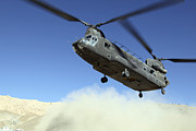 Low Wing Prints - A Ch-47 Chinook Prepares To Land Print by Stocktrek Images