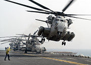 Rotary Wing Aircraft Posters - A Ch-53e Super Stallion Lifts Poster by Stocktrek Images