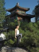 Balance In Life Photo Framed Prints - A Chinese Woman In Her 20s To 30s Doing Framed Print by Justin Guariglia