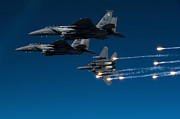 Releasing Framed Prints - A F-15e Strike Eagle Aircraft Releases Framed Print by Stocktrek Images