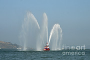 Fireboat Photos - A Fire Boat by Ted Kinsman