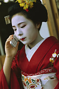 Entertainers Metal Prints - A Kimono-clad Geisha Talks On A Cell Metal Print by Justin Guariglia