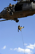 Baghdad Posters - A Pararescueman Rappels From An Hh-60 Poster by Stocktrek Images