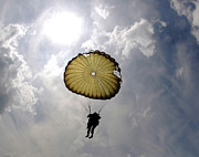 Paratrooper Photo Prints - A Paratrooper Descends Through The Sky Print by Stocktrek Images