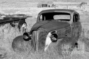 Rusted Cars Photos - A Ride To The Past by Sandra Bronstein