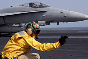 Uss Ronald Reagan Prints - A Shooter Launches An Fa-18e Super Print by Stocktrek Images
