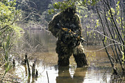 Ghillie Suits Prints - A Sniper Dressed In A Ghillie Suit Print by Stocktrek Images