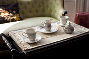 Window Seat Framed Prints - A Sofa In A Living Room And A Tea Tray Framed Print by Christian Scully