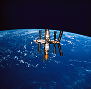 Space Art - A Space Station In Orbit Above The Earth by Stockbyte