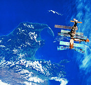 Space Art - A Space Station Orbiting Above Earth by Stockbyte
