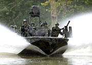 Medium Group Of People Posters - A Special Operations Craft Riverine Poster by Stocktrek Images