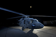 Night Hawk Prints - A Uh-60 Black Hawk Helicopter Parked Print by Terry Moore