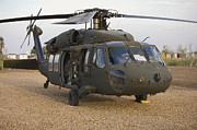 Uh-60 Black Hawk Prints - A Uh-60l Black Hawk With Twin M240g Print by Terry Moore