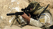 Covering Prints - A U.s. Special Forces Soldier Armed Print by Stocktrek Images