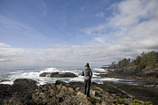 Port Renfrew Framed Prints - A Woman Stands On A Rocky Outcropping Framed Print by Taylor S. Kennedy