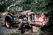 Corrosion Photo Framed Prints - Abandoned Tractor Framed Print by Gert Lavsen