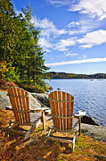 Chairs Art - Adirondack chairs at lake shore by Elena Elisseeva