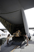 Artillery Metal Prints - Aircrew Load An M777 A2 Howitzer Onto Metal Print by Stocktrek Images
