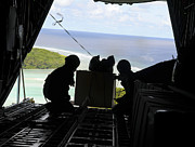 Micronesia Acrylic Prints - Airmen Push Out A Pallet Of Donated Acrylic Print by Stocktrek Images