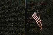 War Monuments And Shrines Prints - American Flag Left At The Vietnam Print by Medford Taylor
