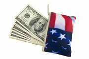 Politics Photo Framed Prints - American Flag Wallet with 100 dollar bills Framed Print by Blink Images