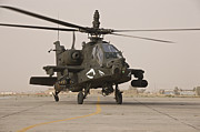 Iraq War Posters - An Ah-64 Apache Helicopter Taxiing Poster by Terry Moore