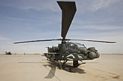 Rotor Blades Photo Prints - An Ah-64d Apache Helicopter At Cob Print by Terry Moore
